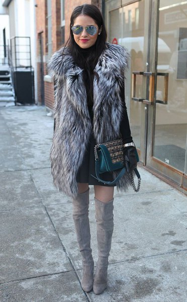 grey long faux fur vest with black sweater dress and thigh high boots
