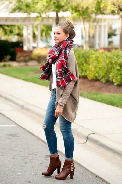grey ribbed sweater cardigan with red plaid scarf and ankle high heel boots
