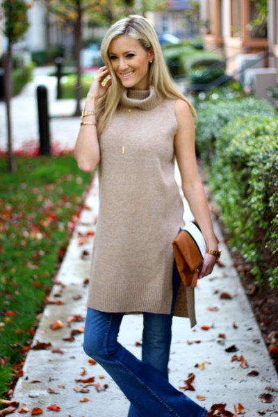 grey sleeveless double slit tunic top with blue flared jeans