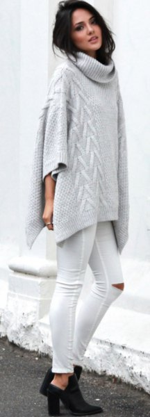 grey turtleneck cable knit poncho sweater with white ripped skinny jeans