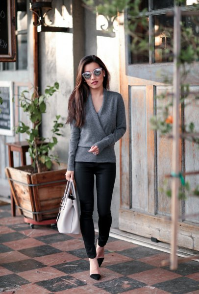 grey wrap sweater with black leggings