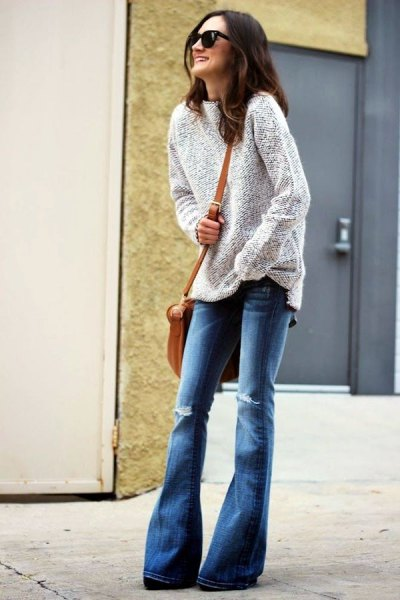 heather grey sweater with blue ripped flared jeans