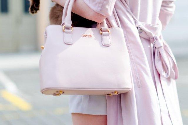 ivory longline wool coat with white soft leather handbag