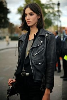 leather motorcycle jacket with black vest and grey top