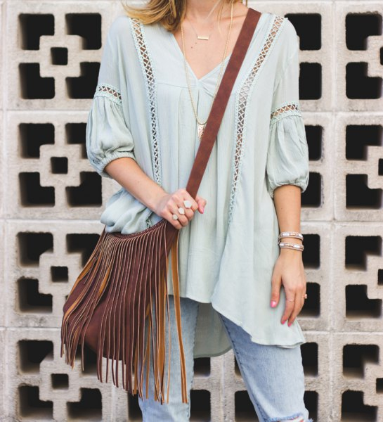 light blue half sleeve v neck tunic top with mini cutout details