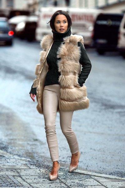 light brown vest with black turtleneck form fitting sweater