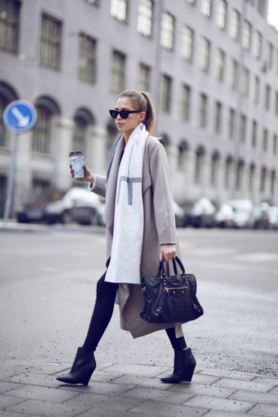 light grey longline wool coat with white long scarf and black ankle leather wedge boots