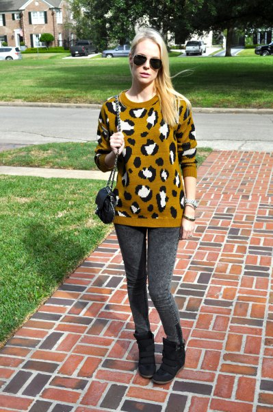 lime green and black printed knit sweater with grey leggings and wedge shoes