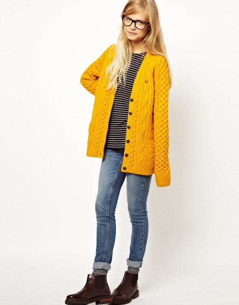 mustard yellow cable knit cardigan with cuffed jeans and leather boots