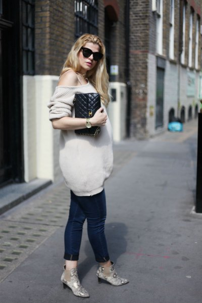 pale pink one shoulder oversized knit sweater with black cropped maternity jeans