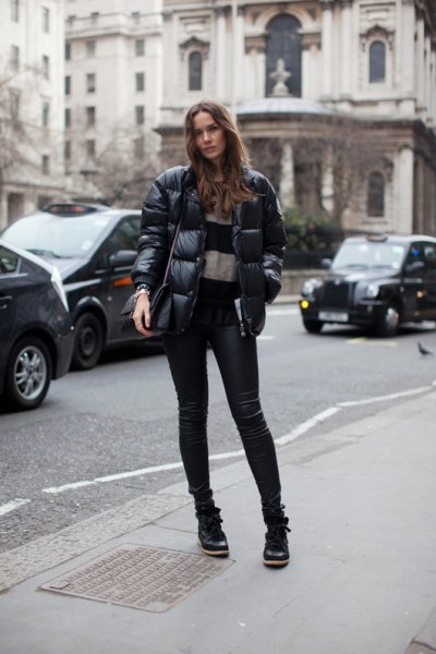 puffer jacket with wide striped sweater with leather pants
