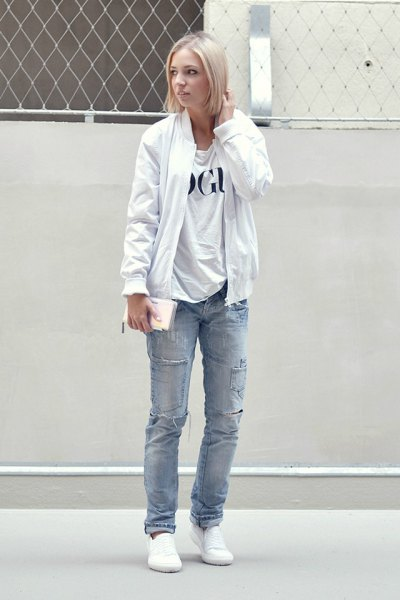 pure white bomber jacket with print tee and blue straight leg jeans