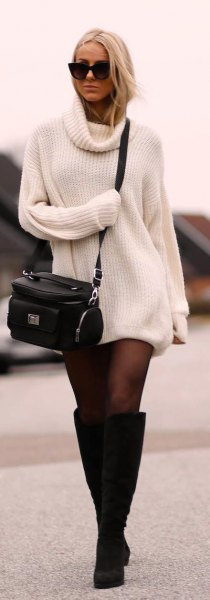 ribbed white sweater dress with black stockings and knee high heeled boots