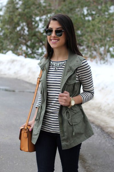 striped long sleeve tee with silver statement necklace and utility vest