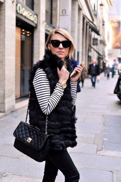 white and black striped long sleeve t shirt with fur vest and slim fit jeans