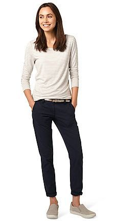 white and light grey striped long sleeve top with black cuffed slim fit jeans