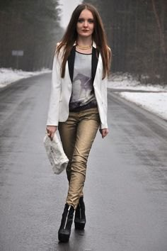 white blazer with grey scoop neck printed tee and golden pants
