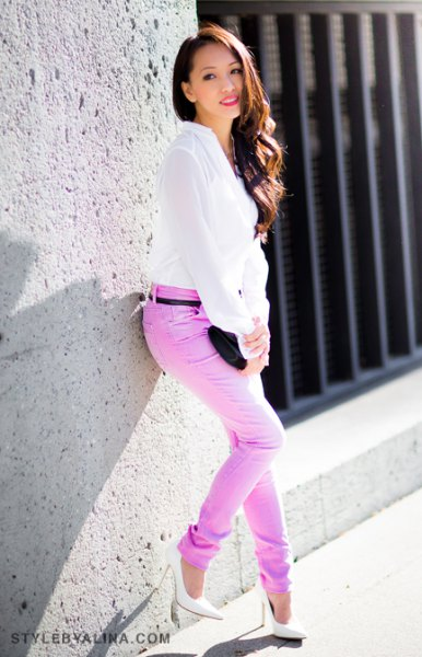white chiffon blouse with colored belted slim fit jeans