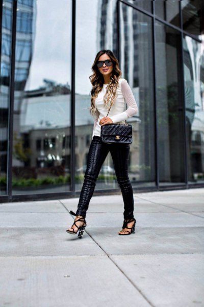 white fitted sweater with black lace up leather pants