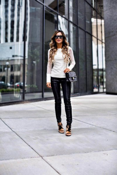white form fitting long sleeve sweater with leather leggings and open toe heels