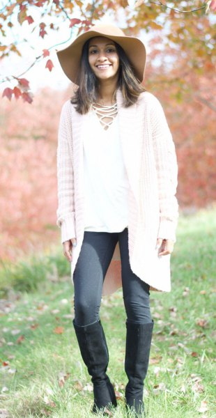 white knit cardigan with grey leggings and knee high boots