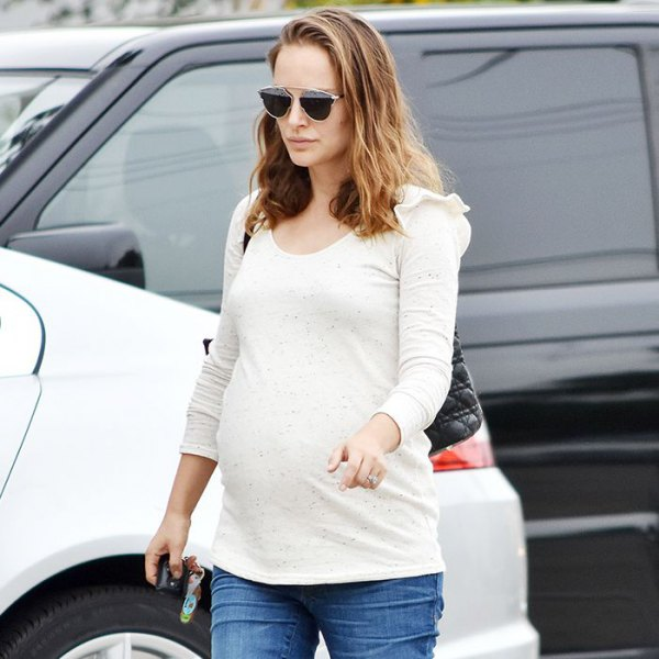 white long sleeve top with blue maternity jeans