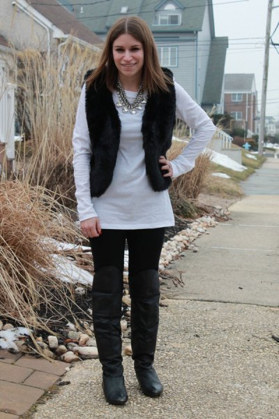 white long sleeve tunic top with black jeans and leather knee high boots