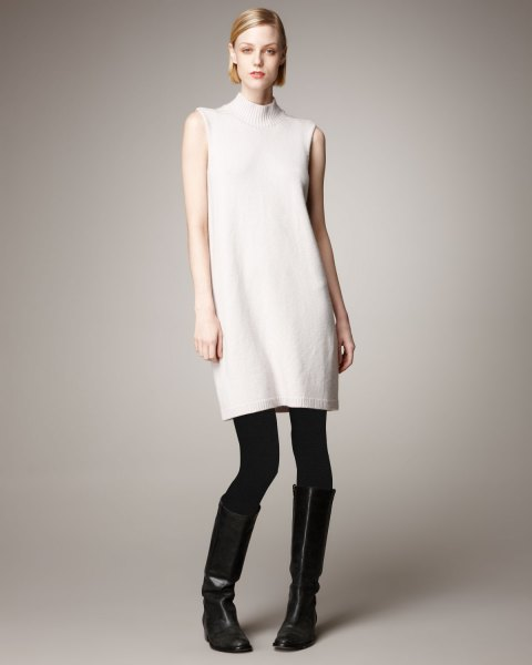 white mock neck sleeveless cashmere longline sweater with leggings and boots