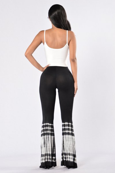 white scoop neck tank top with black tie dye yoga pants