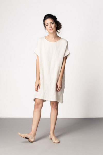 white tunic dress with pale pink leather flats
