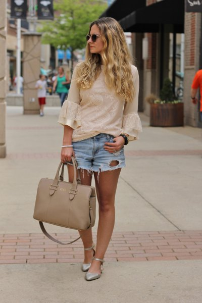 bell sleeve pale pink blouse with light blue mini ripped denim shorts