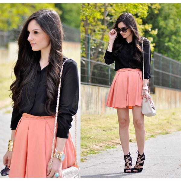 black button up shirt with pale orange mini skater skirt