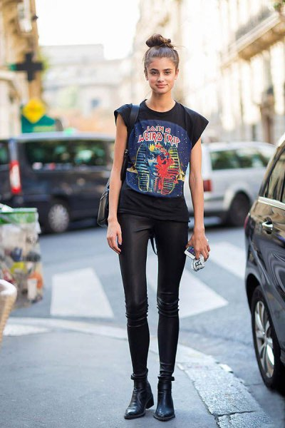 black cap sleeve graphic t shirt with leather skinny pants