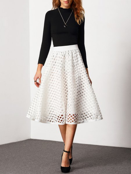 black crew neck fitted sweater with white semi sheer high waisted midi flared skirt