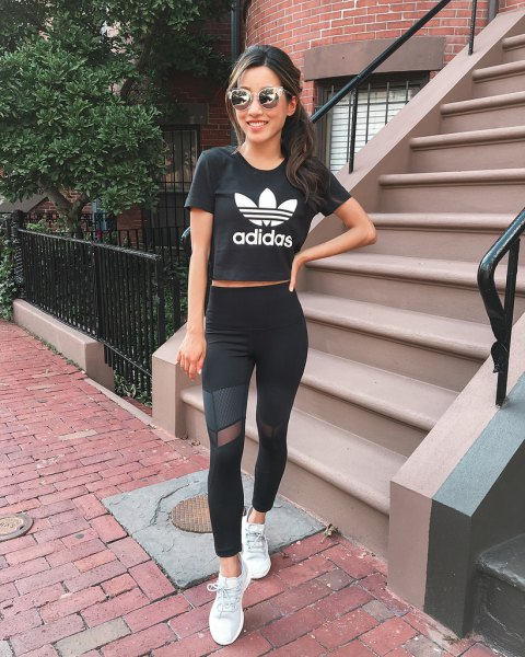 black cropped graphic t shirt with mesh leggings and white sneakers