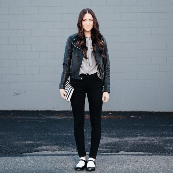 black leather jacket with grey blouse and flats