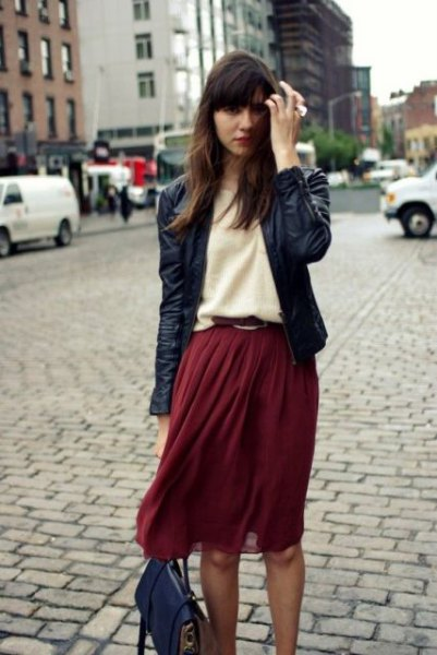 black leather jacket with pale yellow sweater and burgundy chiffon midi skirt