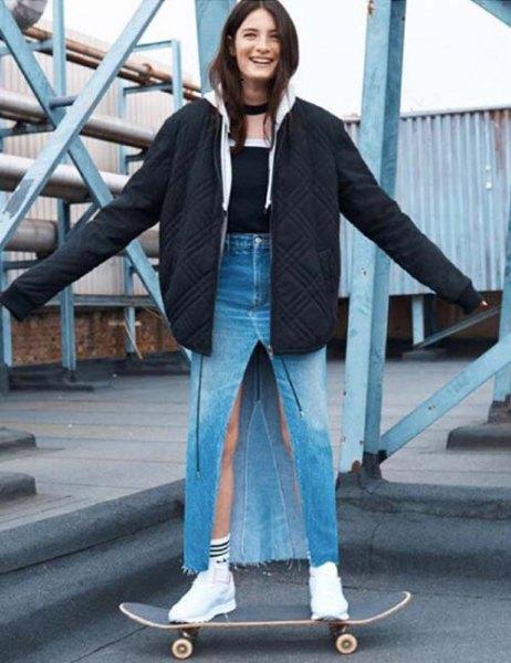 black oversized bomber jacket with high waisted denim maxi slit skirt