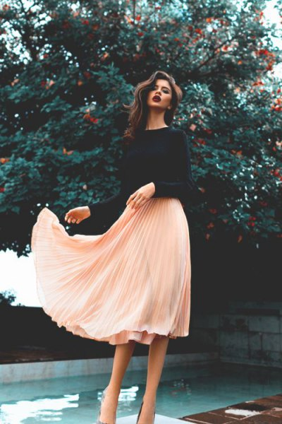 black sweater with pale pink chiffon midi pleated skirt