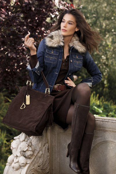 blue denim jacket with black skirt and knee high boots