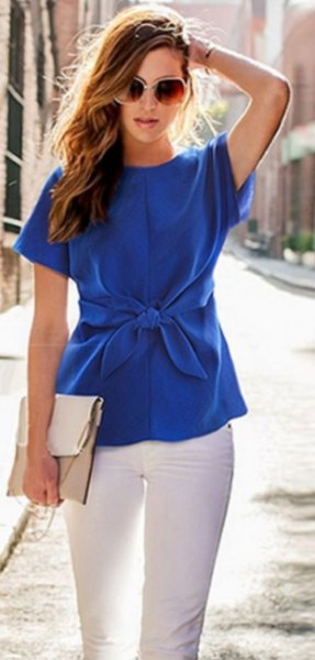 blue tie waist short sleeve silk blouse with white skinny jeans