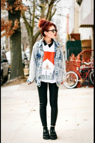 blue washed denim jacket with printed polo shirt and leather leggings