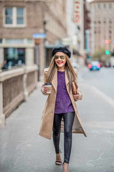 blush pink coat with navy blue sweater and black leather leggings