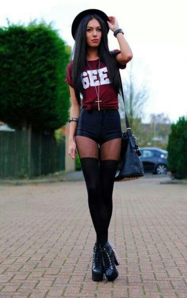 burgundy knotted tee with black mini shorts and thigh high tights