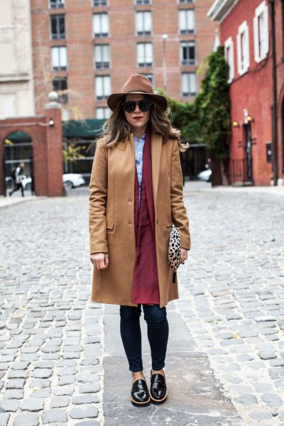 camel walker coat with brown longline coat dress and black leather shoes