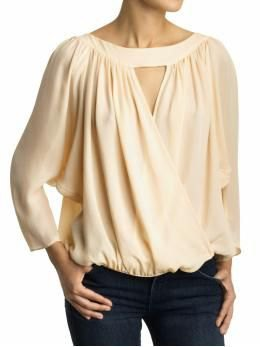 cream keyhole blouse with black skinny jeans