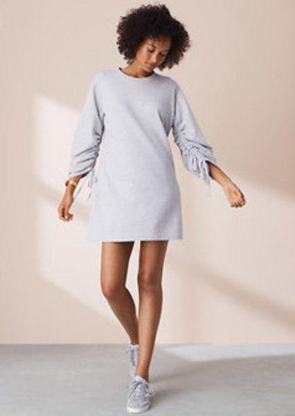 crew neck long sleeve mini sweatshirt dress with low top sneakers