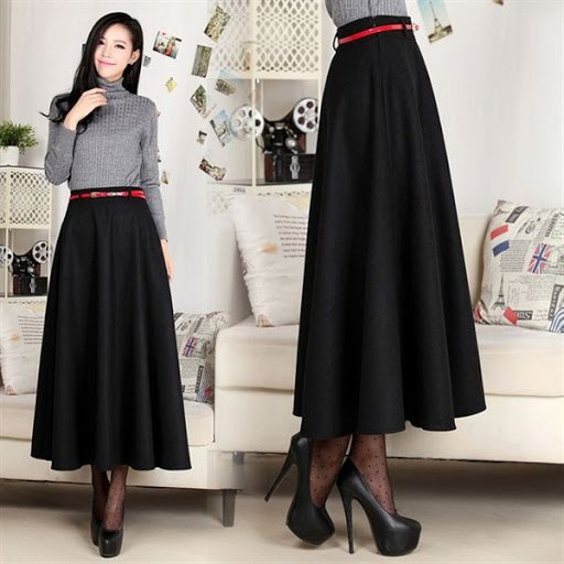 grey mock neck form fitting sweater with black maxi flared skirt