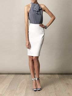 grey tie neck halter top with high waisted white skirt