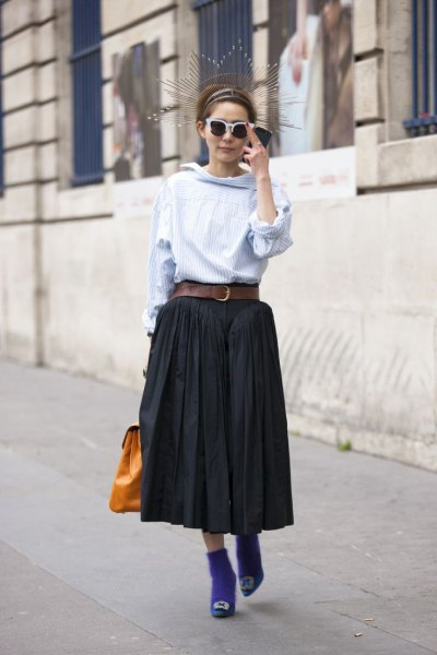 light blue blouse with belted black midi pleated skirt